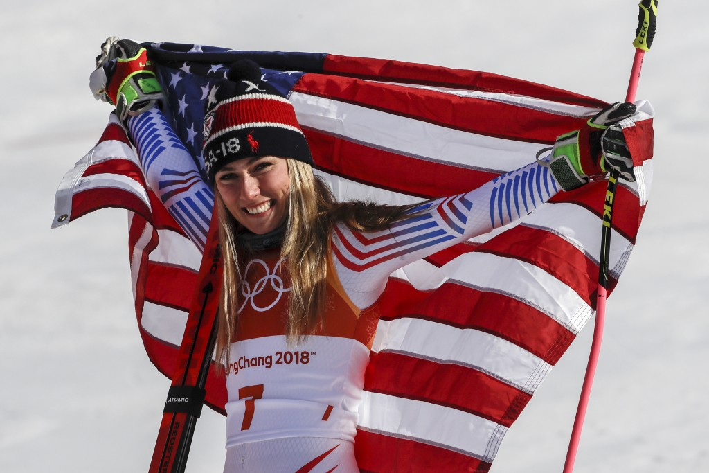 Mikaela Shiffrin, of the United States, celebrate her gold medal during the venue ceremony at the Women's Giant Slalom at the 2018 Winter Olympics in