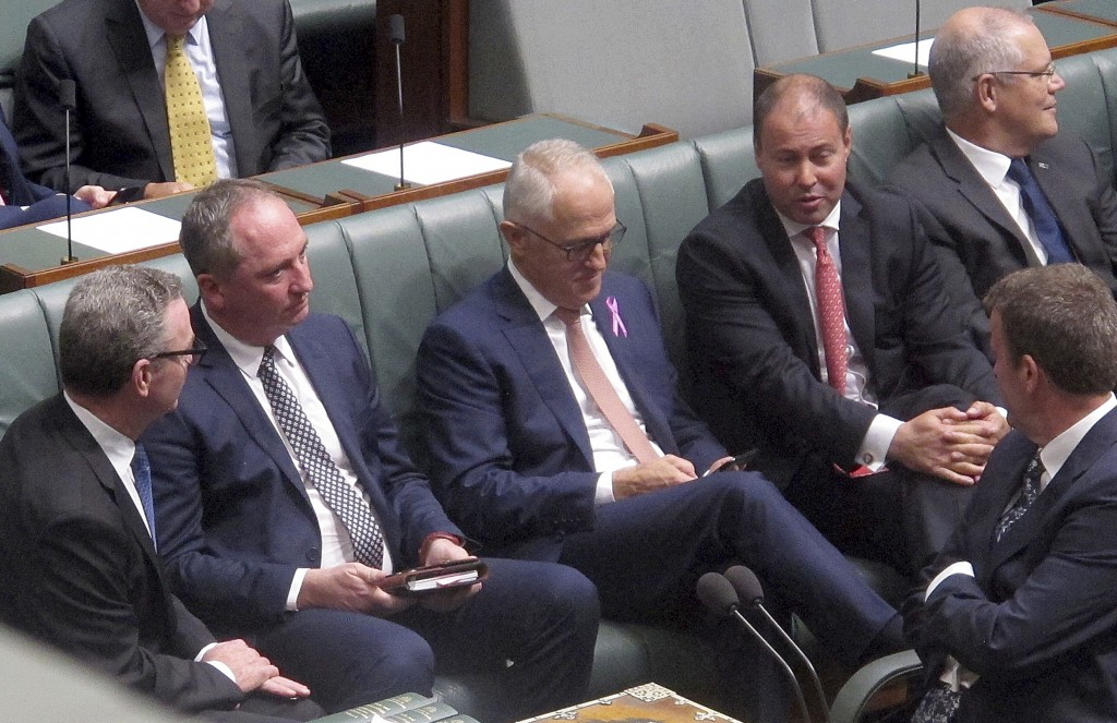 Australian Deputy Prime Minster Barnaby Joyce, second from left, sits with colleagues including Prime Minister Malcolm Turnbull, center, during a sess