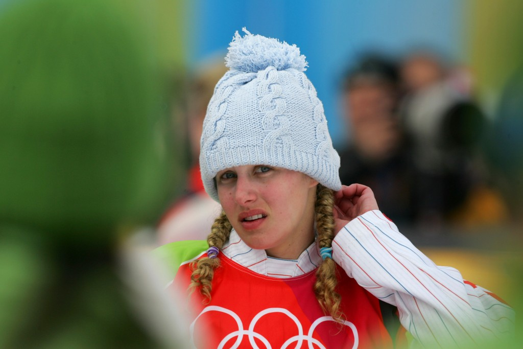 FILE - In this Friday, Feb. 17, 2006 file photo, silver medallist Lindsey Jacobellis, of the United States, reacts prior to the flower ceremony of the