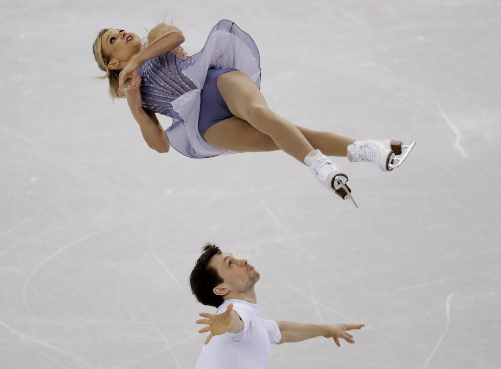 Kirsten Moore-Towers and Michael Marinaro, of Canada, perform in the pairs free skate figure skating final in the Gangneung Ice Arena at the 2018 Wint