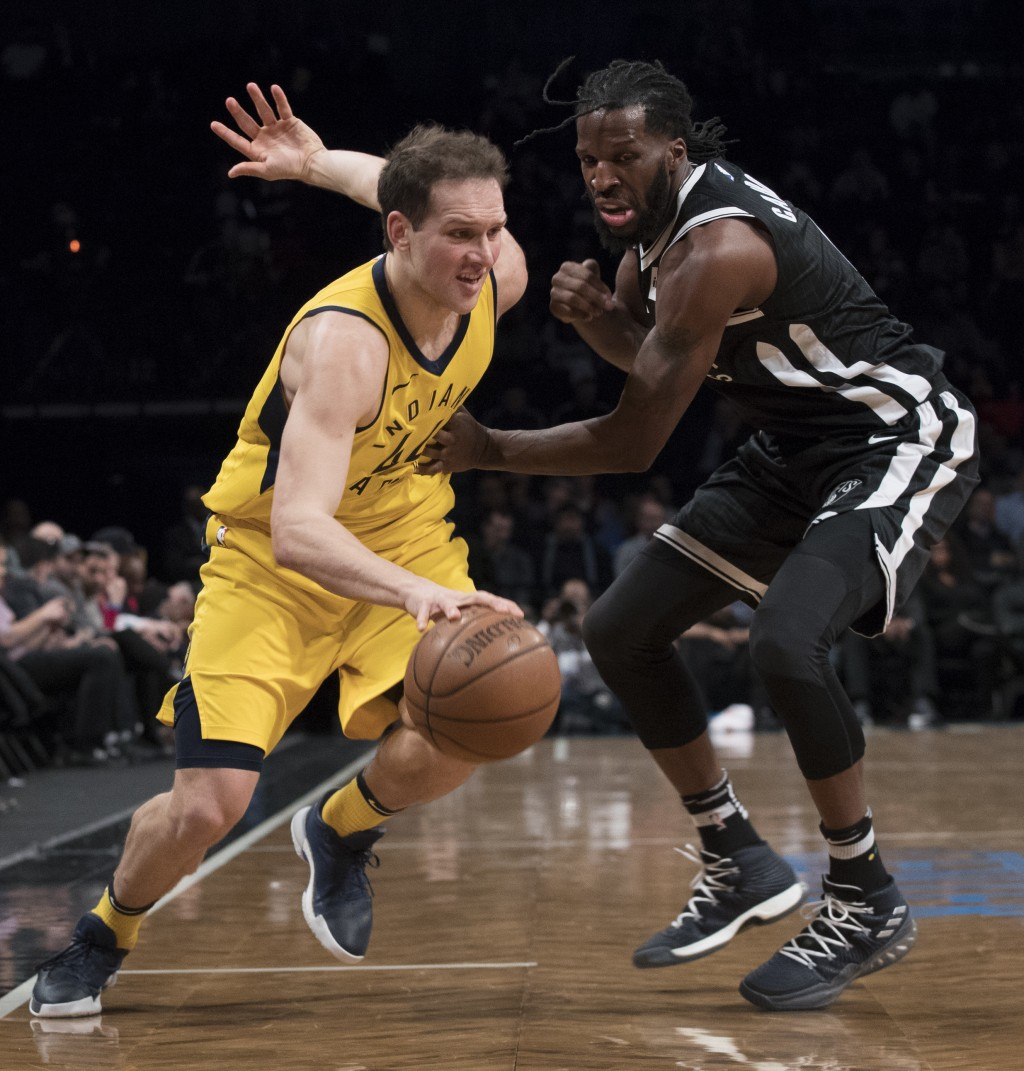 Indiana Pacers forward Bojan Bogdanovic (44) drives to the basket against Brooklyn Nets forward DeMarre Carroll during the first half of an NBA basket