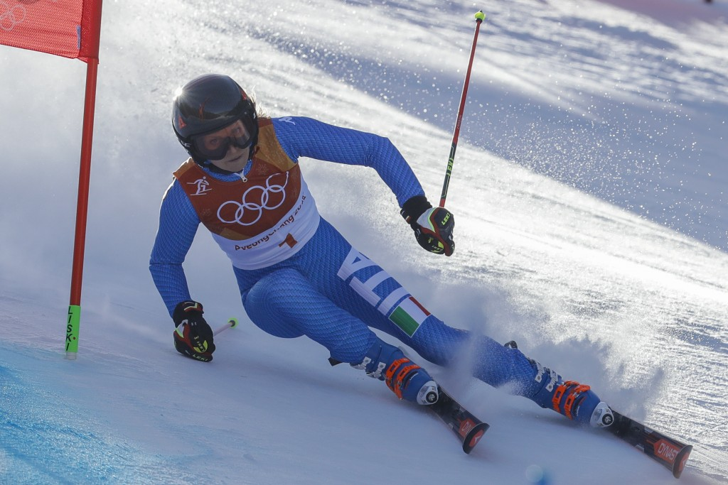 Manuela Moelgg, of Italy, attacks the gate during the first run of the Women's Giant Slalom at the 2018 Winter Olympics in Pyeongchang, South Korea, T