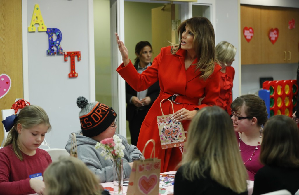 First lady Melania Trump gestures as she speaks during her visit to the Children's Inn at the National Institute of Health, Wednesday, Feb. 14, 2018,