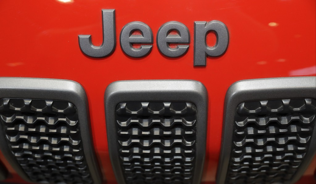 FILE- In this Feb. 8, 2018, file photo, a Jeep Cherokee sits on display at the Chicago Auto Show in Chicago. Trout Unlimited President and CEO Chris W