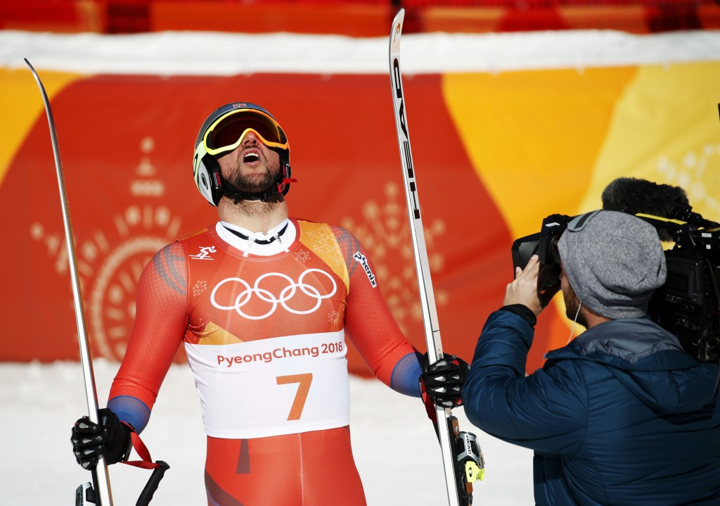 Norway's Aksel Lund Svindal celebrates in the finish area after competing in the men's downhill at the 2018 Winter Olympics in Jeongseon, South Korea,