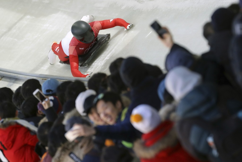 Matthias Guggenberger of Austria brakes in the finish area during the men's skeleton competition at the 2018 Winter Olympics in Pyeongchang, South Kor