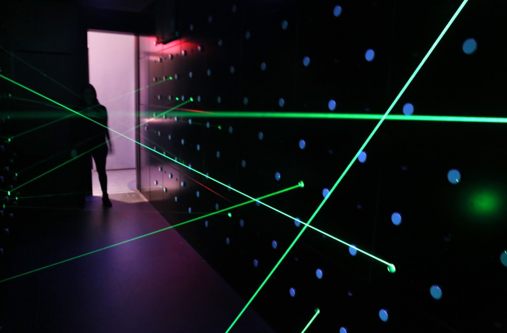 In this Monday, Feb. 12, 2018 photo, lasers fill a room that challenges visitors to pass through without touching them at SPYSCAPE in New York. Visito