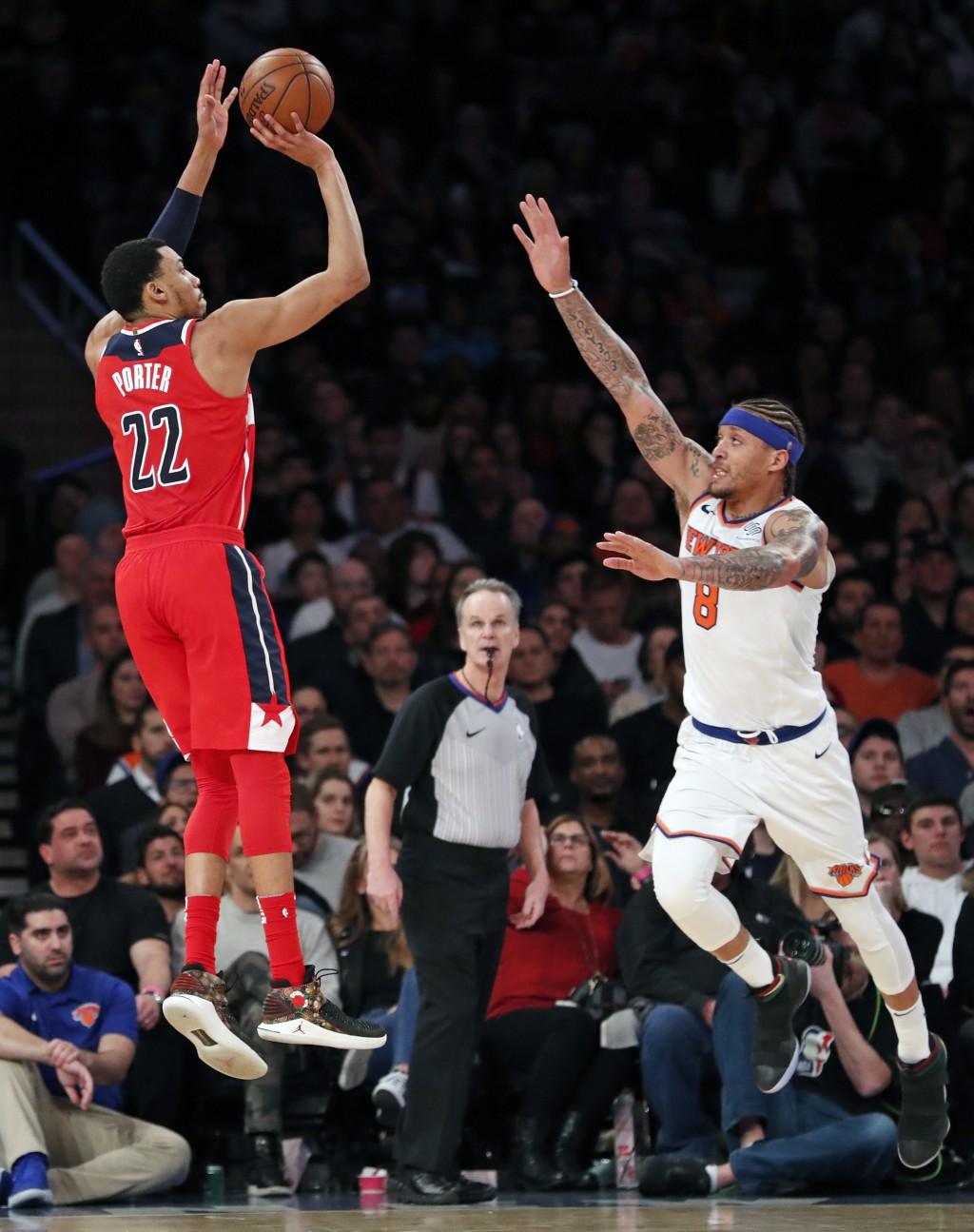 Washington Wizards forward Otto Porter Jr. (22) shoots a three-pointer as New York Knicks forward Michael Beasley (8) defend in the second half of an