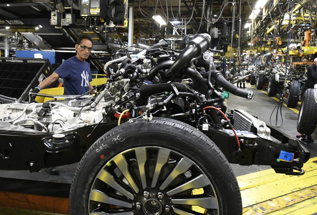 In this Oct. 27, 2017, photo, workers assembling Ford trucks at the Ford Kentucky Truck Plant in Louisville, Ky. On Thursday, Feb. 15, 2018, the Feder