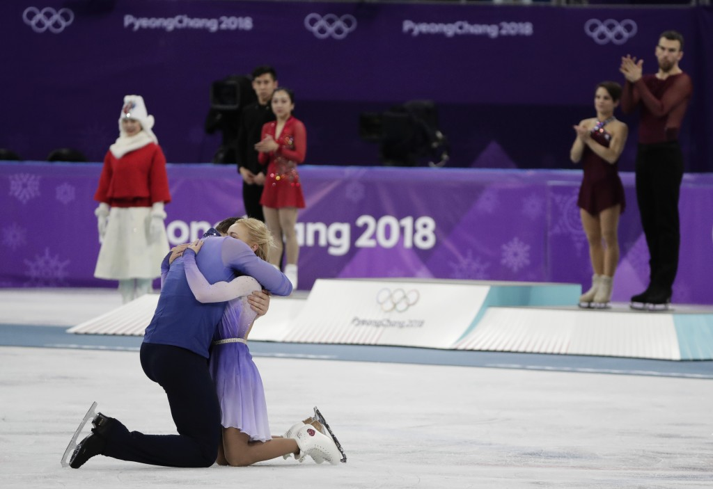 Aljona Savchenko and Bruno Massot of Germany embrace as they celebrate during the venue ceremony after winning the gold medal in the pairs free skate