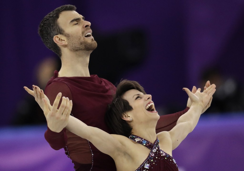 Meagan Duhamel and Eric Radford of Canada react after their performance in the pairs free skate figure skating final in the Gangneung Ice Arena at the