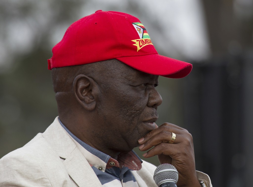 FILE - In this Saturday, Aug. 5, 2017 file photo, Zimbabwe's main opposition party leader Morgan Tsvangirai pauses as he addresses supporters at a ral