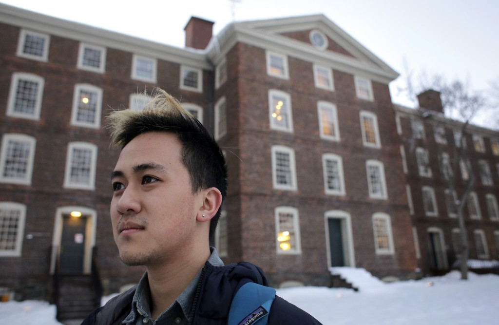 FILE - In this Feb. 14, 2017 file photo, Viet Nguyen poses for a portrait on the Brown University campus in Providence, R.I. Nguyen, now an alumnus, h