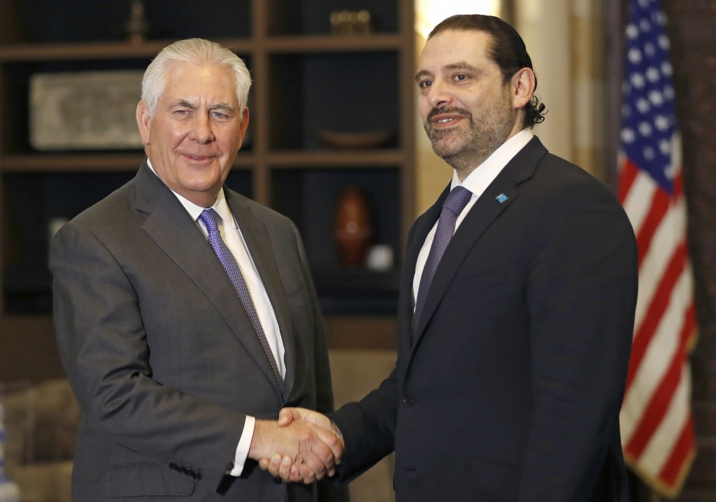 Lebanese Prime Minister Saad Hariri, right, shakes hands with U.S. Secretary of State Rex Tillerson, at the Government House, in Beirut, Lebanon, Thur