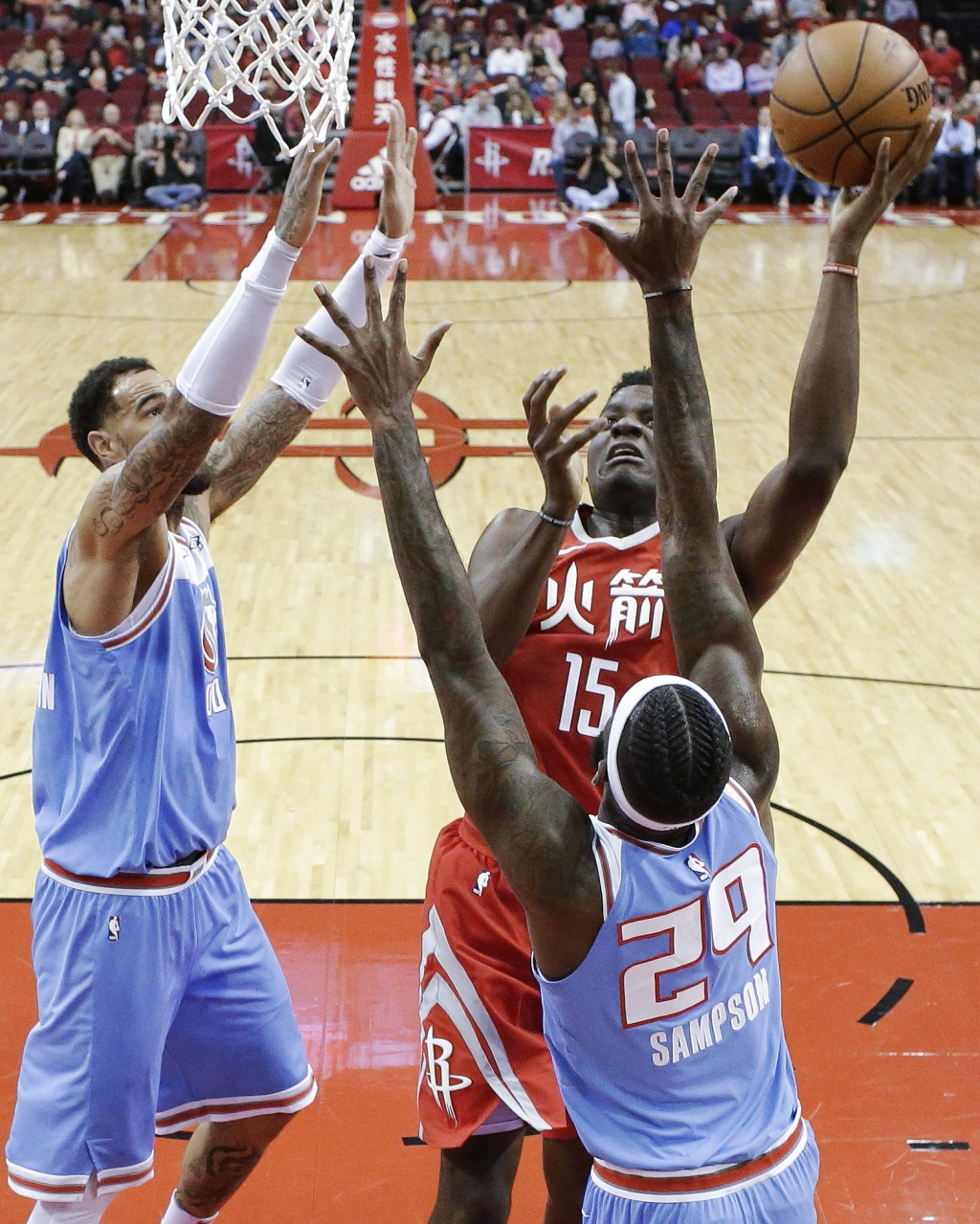Houston Rockets center Clint Capela (15) shoots as Sacramento Kings forward JaKarr Sampson (29) and center Willie Cauley-Stein defend during the first