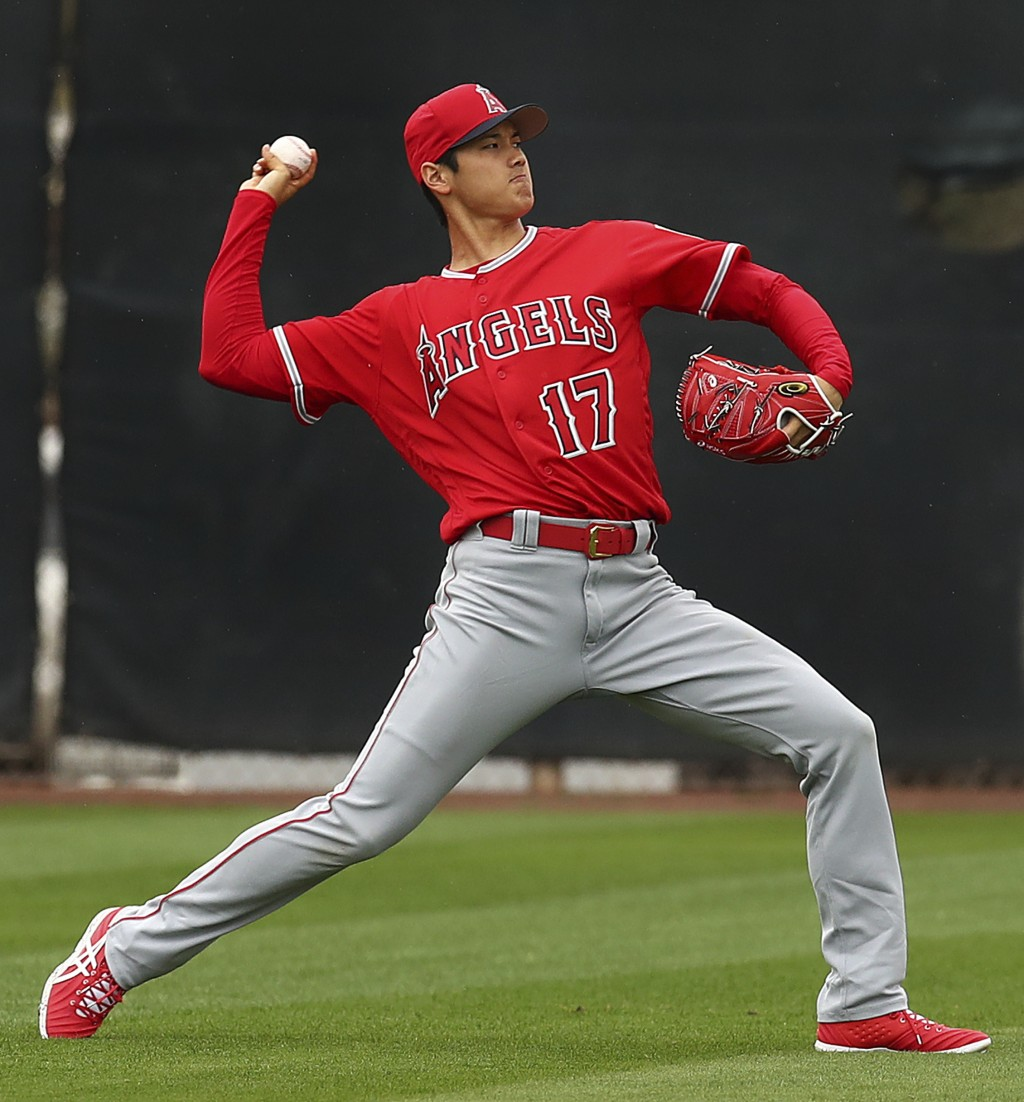 Los Angeles Angels' Shohei Ohtani throws during a spring training baseball practice on Wednesday, Feb. 14, 2018, in Tempe, Ariz. (AP Photo/Ben Margot)