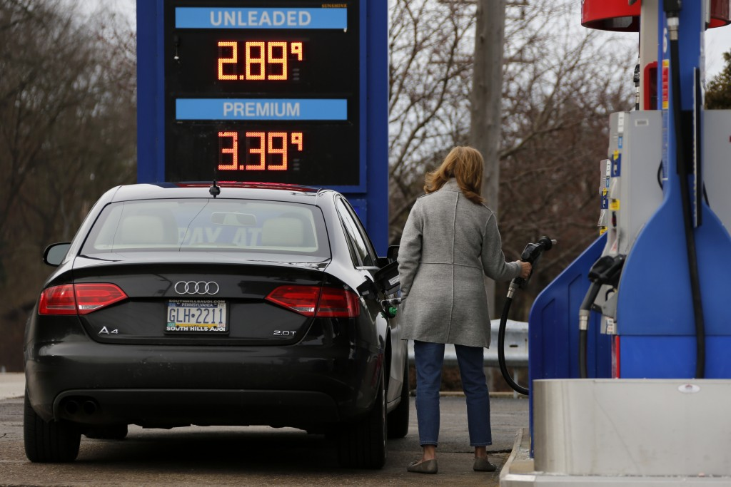 FILE- In this Jan. 22, 2018, file photo, a motorist pumps gas in Bethel Park, Pa. On Thursday, Feb. 15, 2018, the Labor Department reports on U.S. pro
