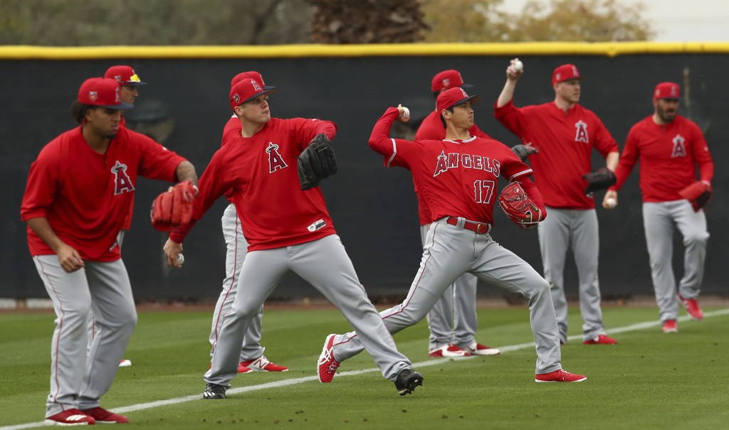 Los Angeles Angels' Shohei Ohtani (17) throws alongside other pitchers during a spring training baseball practice on Wednesday, Feb. 14, 2018, in Temp
