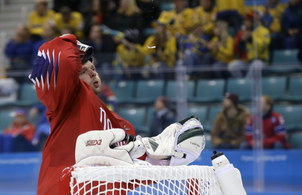 Goalie Lars Haugen (30), of Norway, reacts after giving up a goal to Par Lindholm, of Sweden, during the first period of the preliminary round of the