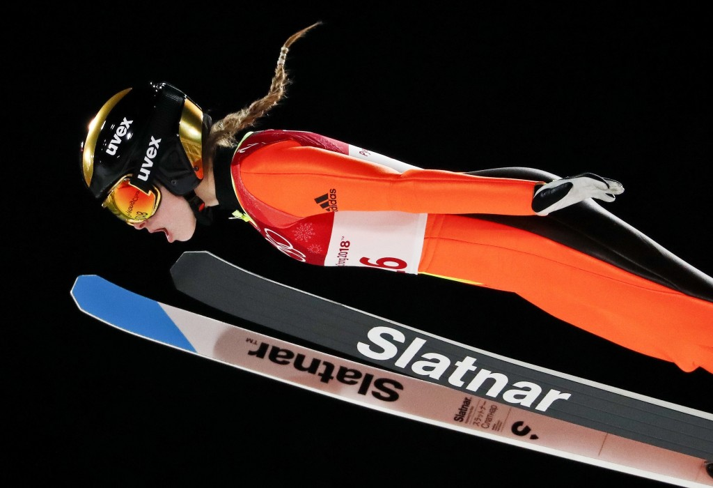 Nika Kriznar, of Slovenia, soars through the air during the women's normal hill individual ski jumping competition at the 2018 Winter Olympics in Pyeo