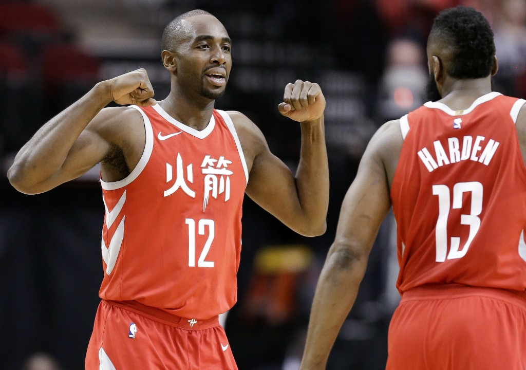 Houston Rockets forward Luc Mbah a Moute (12) celebrates after drawing a foul, as guard James Harden watches during the first half of the team's NBA b