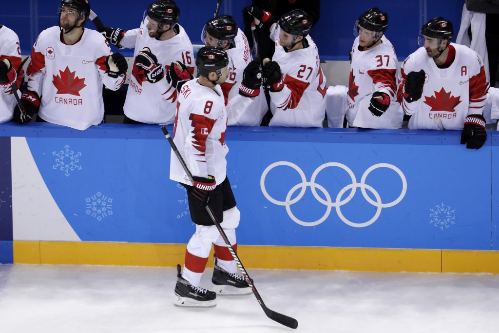Wojtek Wolski (8), of Canada, celebrates with the bench after scoring a goal on Switzerland during the third period of a preliminary round men's hocke