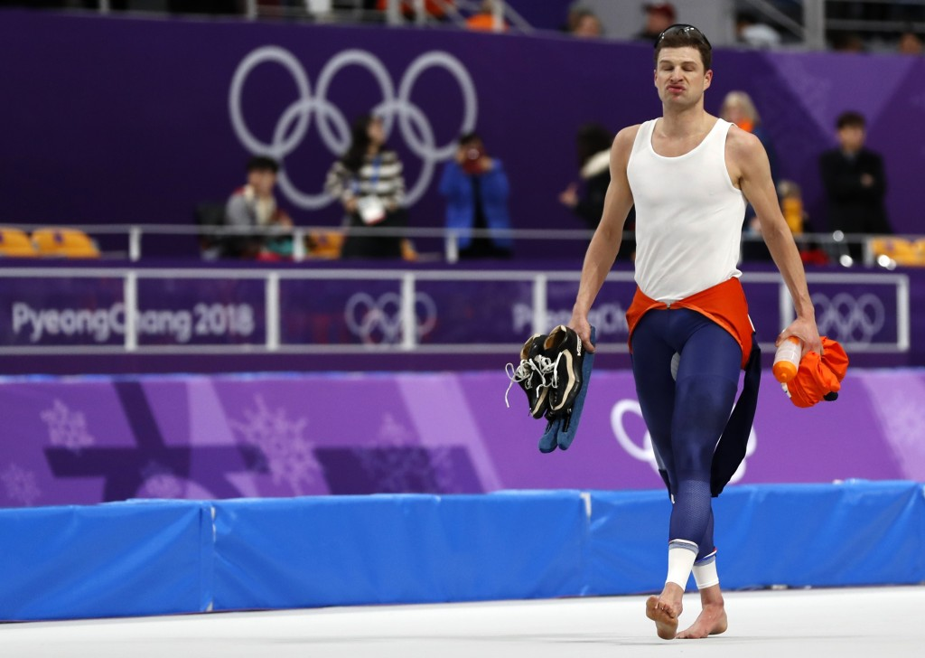 Sven Kramer of The Netherlands reacts as he sits with his coaches after his performance on the men's 10,000 meters speedskating race at the Gangneung