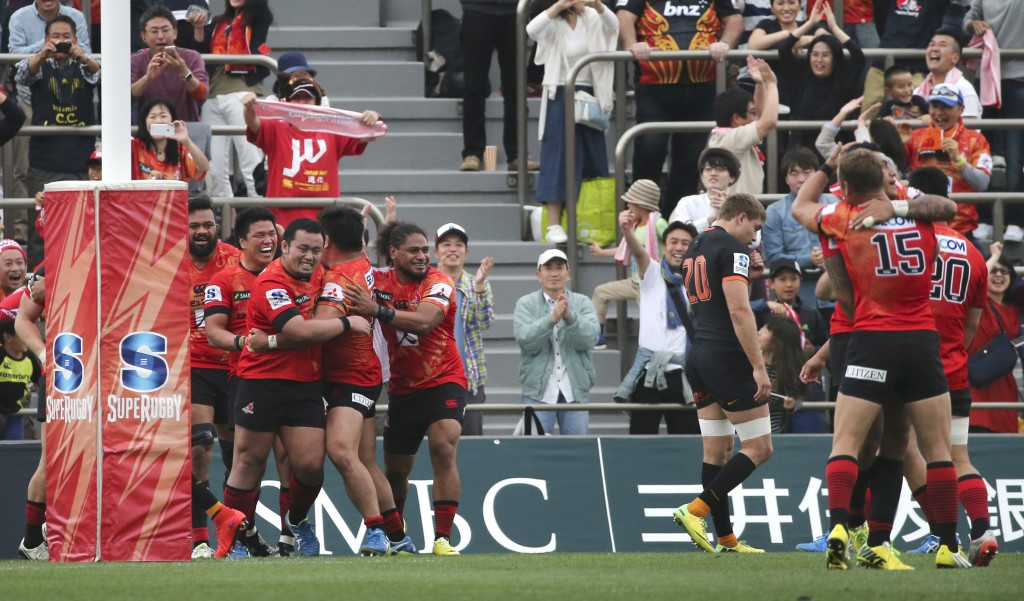 FILE - In this April 23, 2016, file photo, players of Japan's Sunwolves celebrate their 36-28 win over Argentina's Jaguares, in black, during their Su