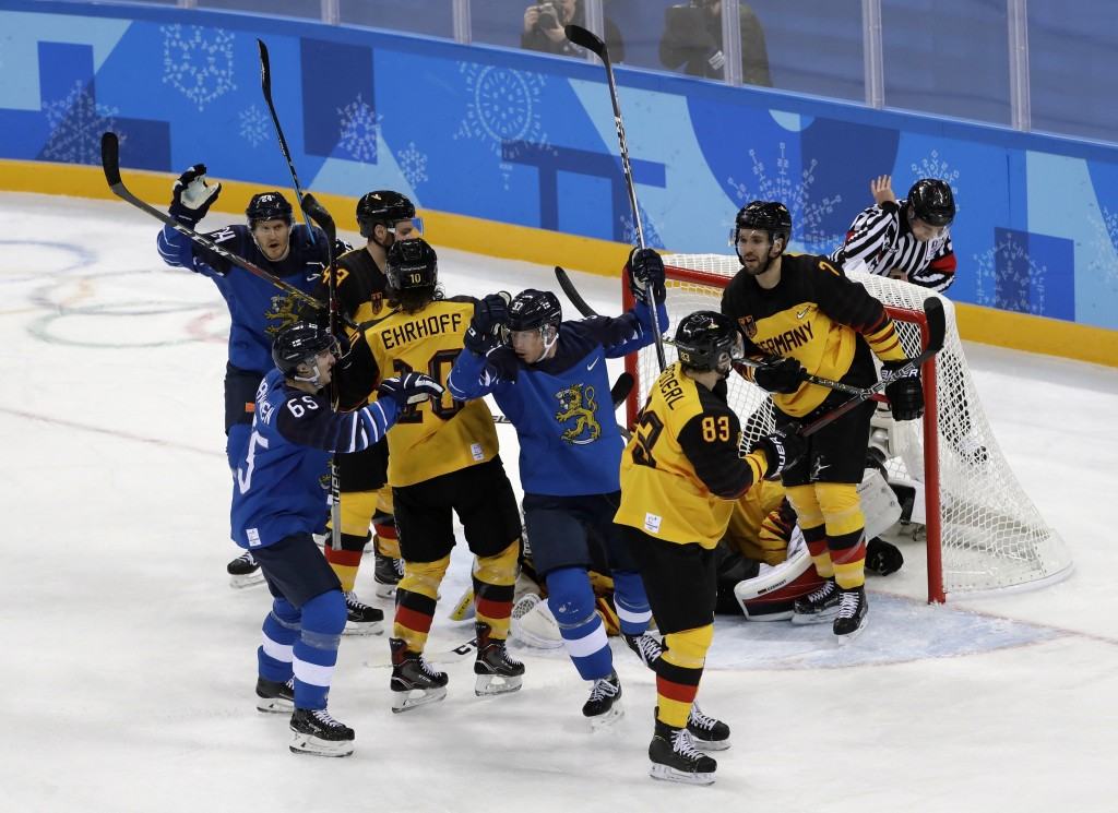 Mika Pyorala (37), of Finland, celebrates after scoring a goal against Germany during the first period of the preliminary round of the men's hockey ga