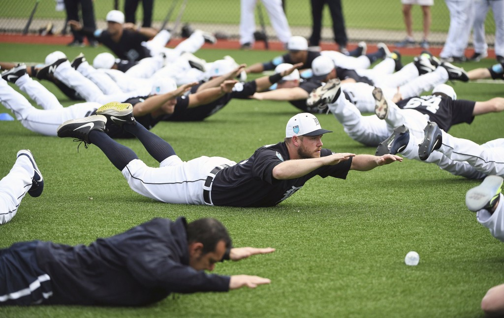 Detroit Tigers pitcher Alex Wilson does an exercise with the rest of the players during spring baseball practice, Wednesday, Feb. 14, 2018 in Lakeland