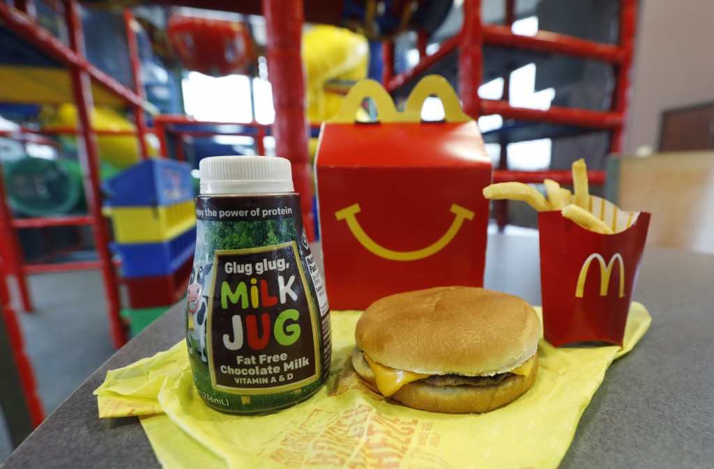 A Happy Meal featuring non-fat chocolate milk and a cheeseburger with fries, are arranged for a photo at a McDonald's restaurant in Brandon, Miss., We