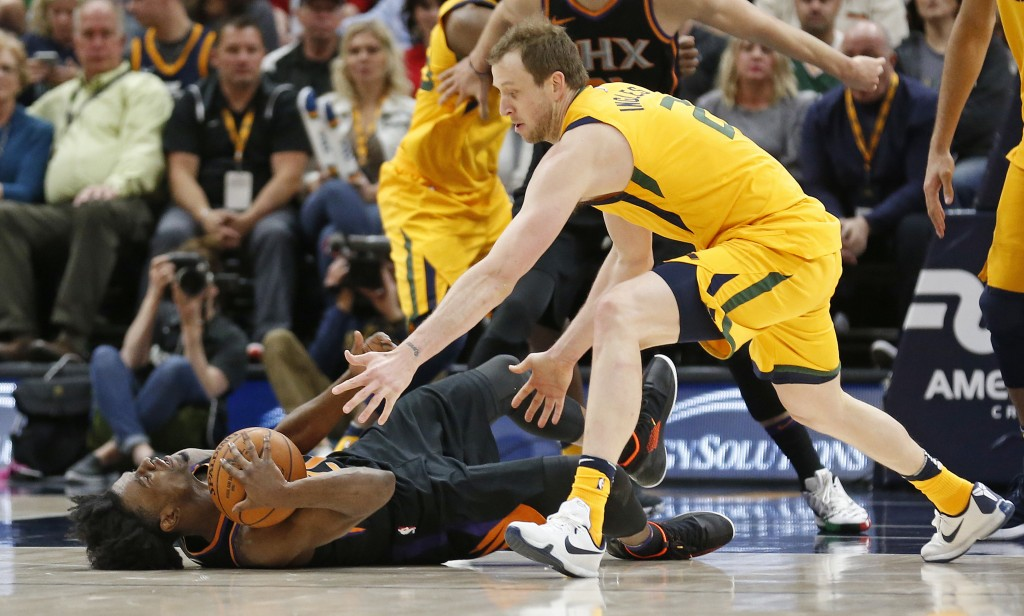 Phoenix Suns forward Josh Jackson, left, and Utah Jazz forward Joe Ingles, right, battle for a loose ball in the first half during an NBA basketball g