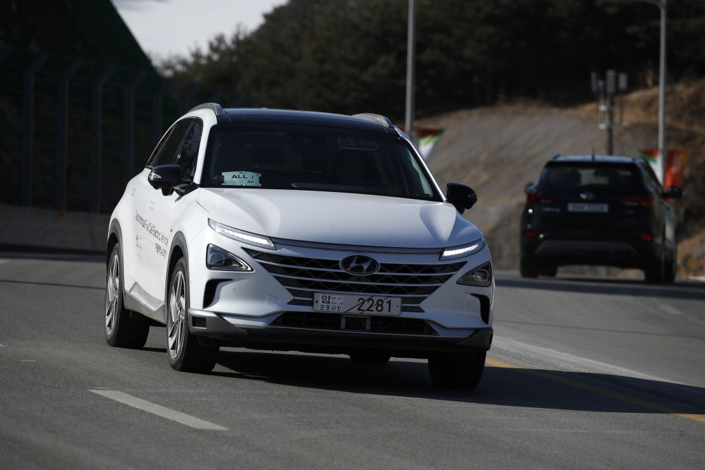 In this Monday, Feb. 12, 2018, photo, Hyundai's autonomous fuel cell electric vehicle Nexo is driven along a road near the Pyeongchang Olympic Stadium