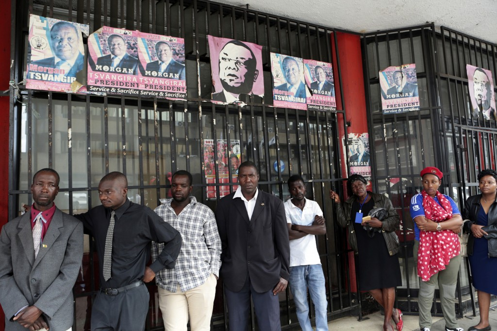 Supporters of Morgan Tsvangirai are seen outside his party headquarters in Harare, Zimbabwe Thursday, Feb. 15, 2018. Zimbabwean opposition leader Morg