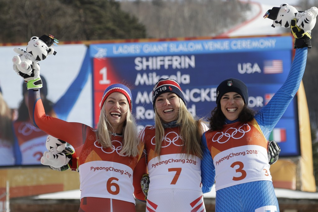 Silver medalist Ragnhild Mowinckel, of Norway, right, gold medalist Mikaela Shiffrin, of the United States, center, and bronze medalist Federica Brign