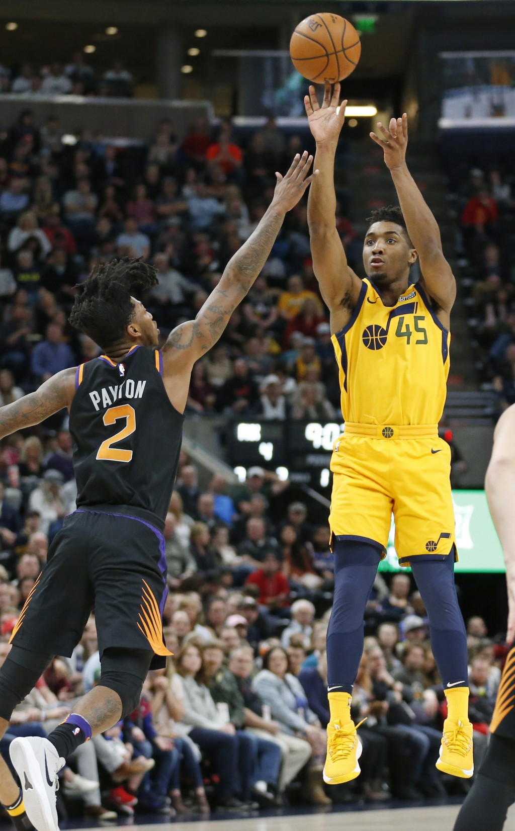 Utah Jazz guard Donovan Mitchell (45) shoots as Phoenix Suns guard Elfrid Payton (2) defends in the first half during an NBA basketball game Wednesday