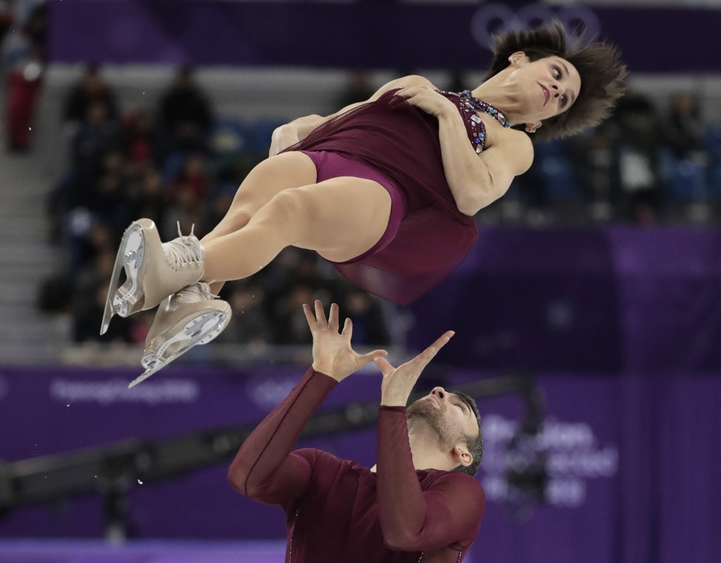 Meagan Duhamel and Eric Radford of Canada perform in the pairs free skate figure skating final in the Gangneung Ice Arena at the 2018 Winter Olympics