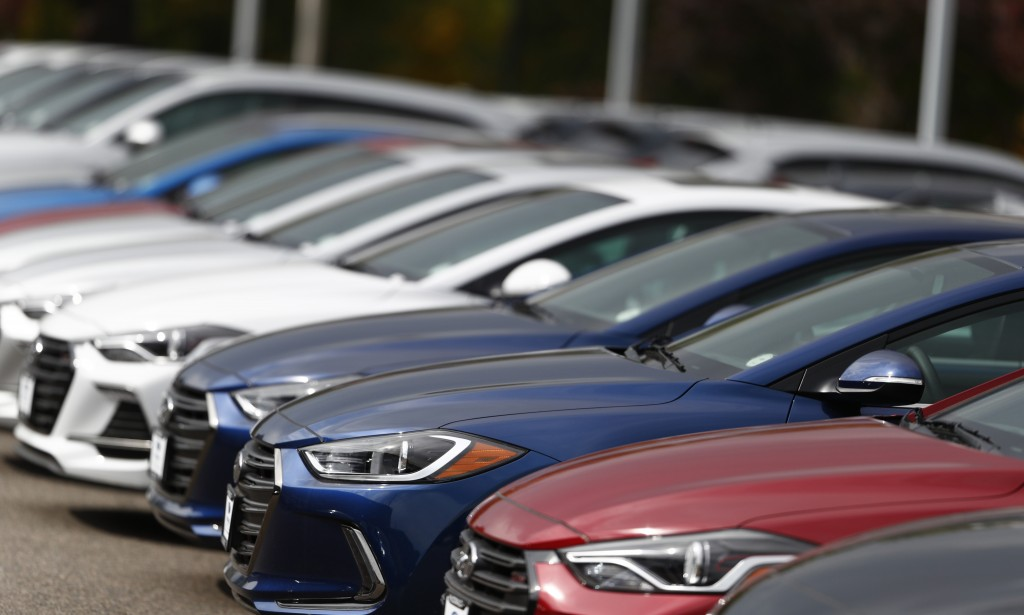 In this Friday, Oct. 6, 2017, a long line of unsold 2018 Sonatas sits outside a Hyundai dealership in the south Denver suburb of Littleton, Colo. Even