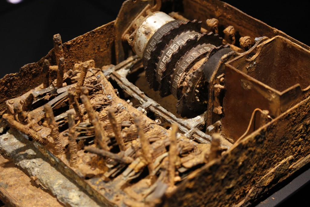 """In this Monday, Feb. 12, 2018 photo, an """"Enigma"""" machine destroyed by German troops in the field is displayed at SPYSCAPE in New York. Visitors to a n"""