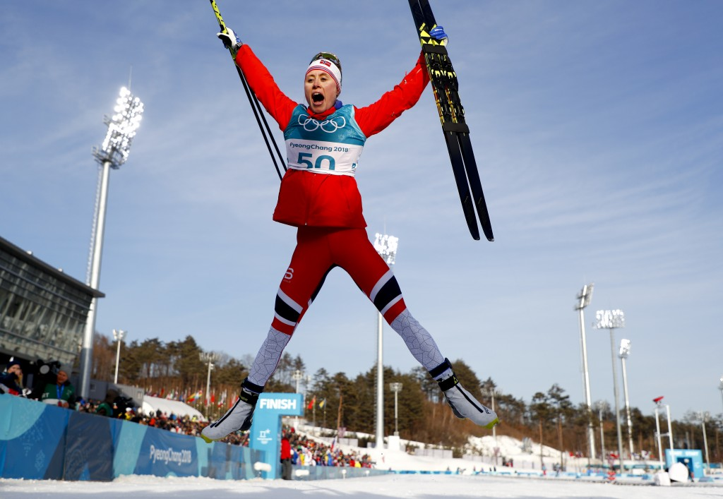 Ragnhild Haga, of Norway, celebrates after winning the gold medal in the women's 10km freestyle cross-country skiing competition at the 2018 Winter Ol