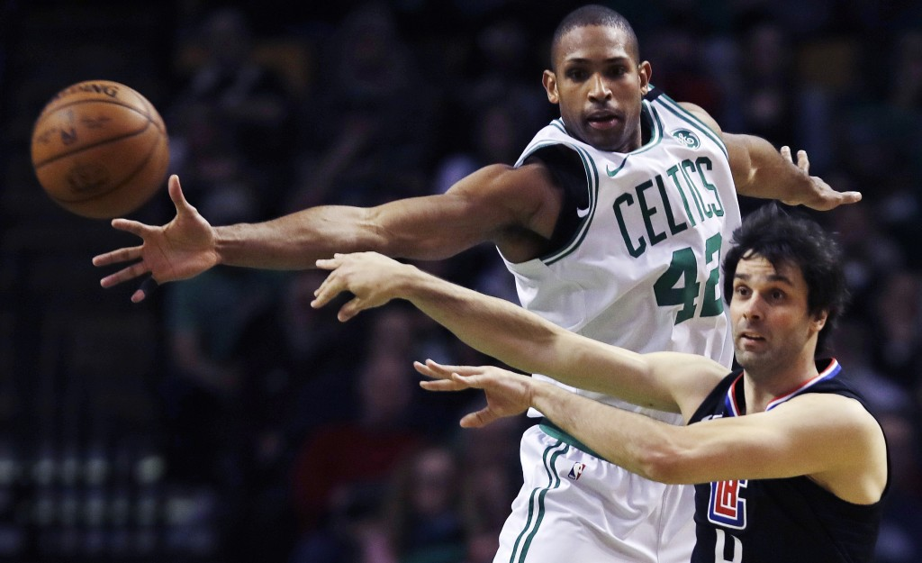 Los Angeles Clippers guard Milos Teodosic, right, passes the ball as he is pressured by Boston Celtics forward Al Horford (42) during the second quart