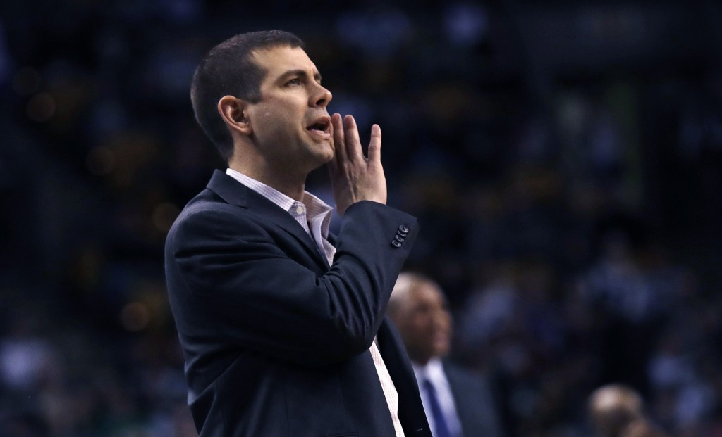 Boston Celtics coach Brad Stevens calls to his players during the first quarter of an NBA basketball game against the Los Angeles Clippers in Boston,