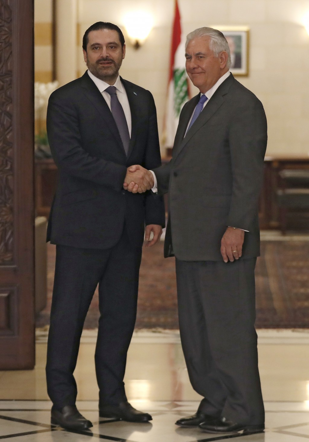 Lebanese Prime Minister Saad Hariri, left, shakes hands with U.S. Secretary of State Rex Tillerson, right, at the Government House, in Beirut, Lebanon