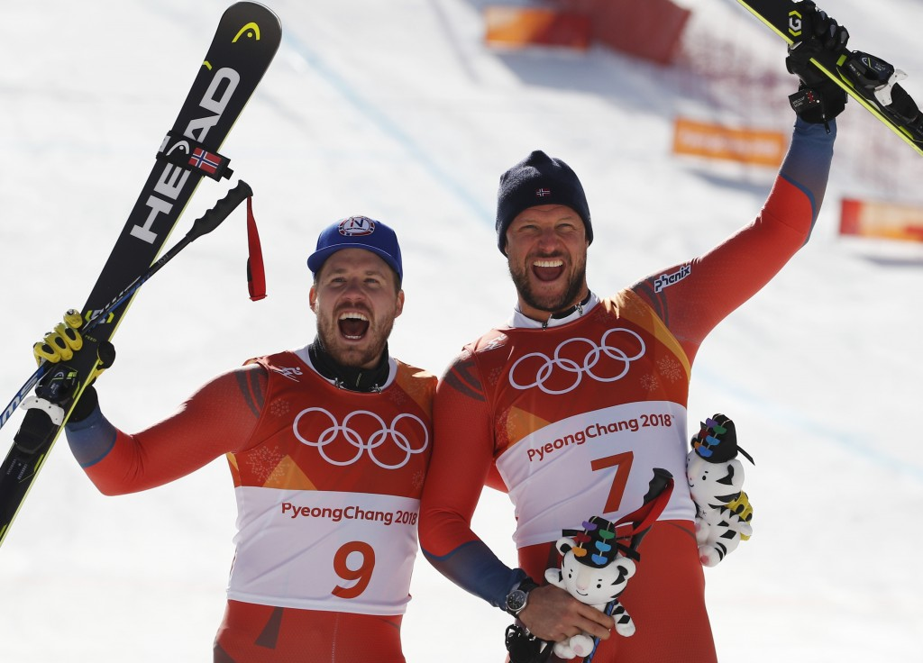 From left, Norway's Kjetil Jansrud, silver, and Norway's Aksel Lund Svindal, gold, celebrate during the flower ceremony for the men's downhill at the