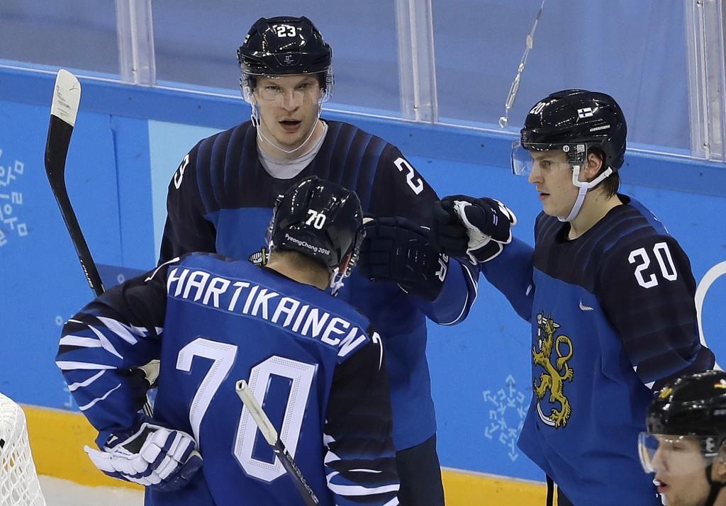 Joonas Kemppainen (23), of Finland, celebrates his goal with Teemu Hartikainen (70) and Eeli Tolvanen (20) during the XXX period of the preliminary ro