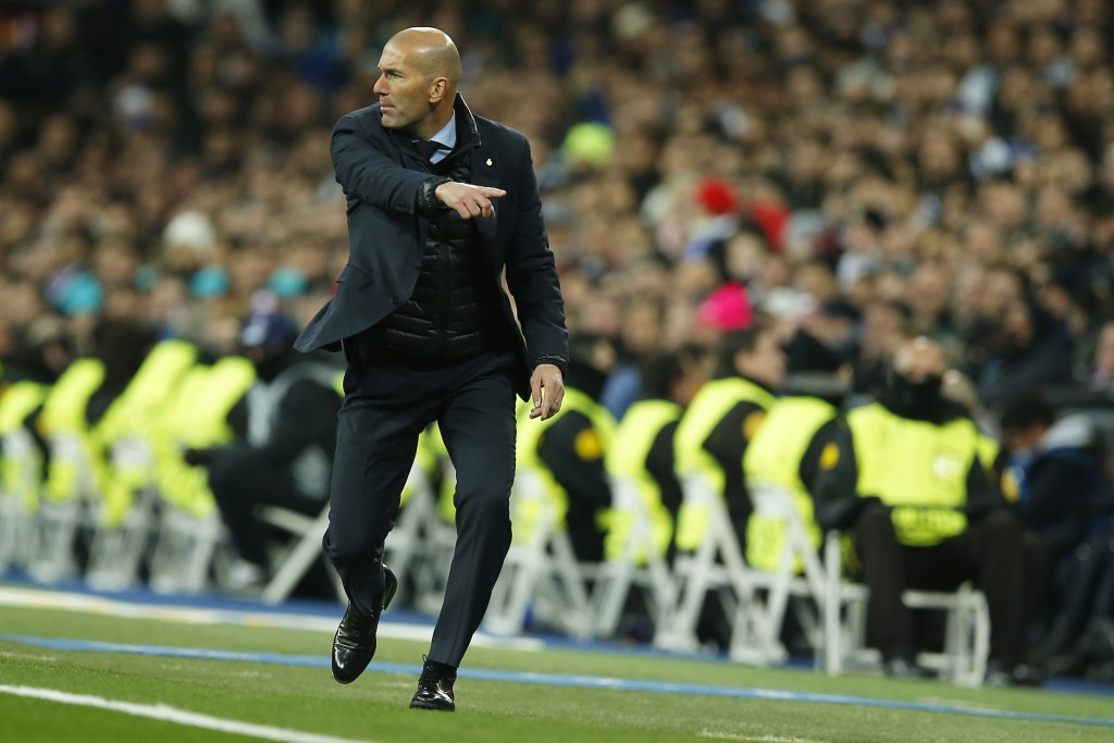 Real Madrid coach Zinedine Zidane gives instructions to his players during the Champions League soccer match, round of 16, 1st leg between Real Madrid