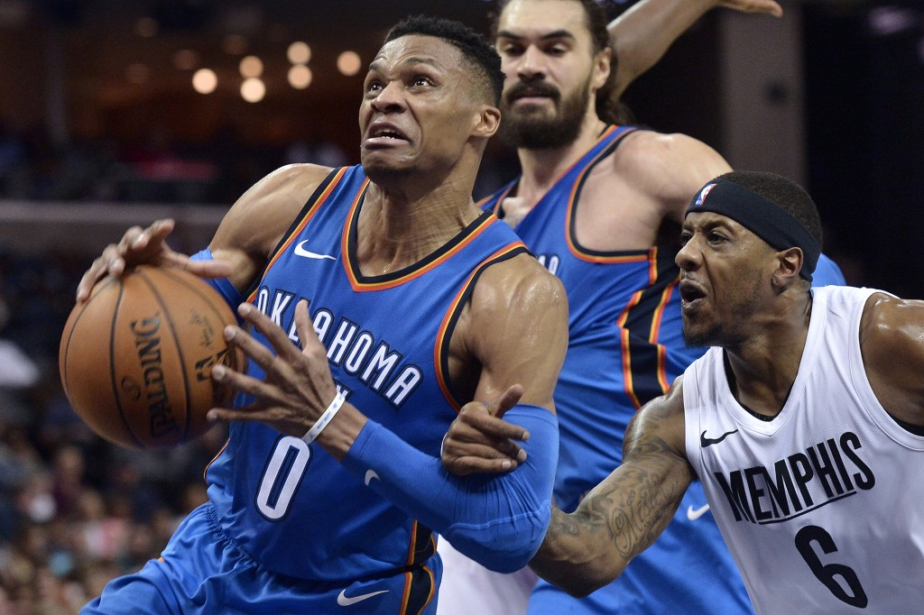 Oklahoma City Thunder guard Russell Westbrook (0) is fouled by Memphis Grizzlies guard Mario Chalmers (6) as he drives to the basket in the first half