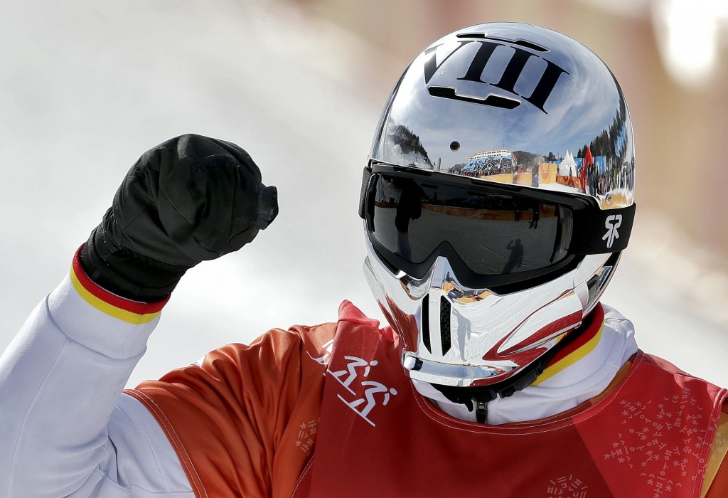 Regino Hernandez, of Spain, celebrates after his run during the men's snowboard cross semifinals at Phoenix Snow Park at the 2018 Winter Olympics in P
