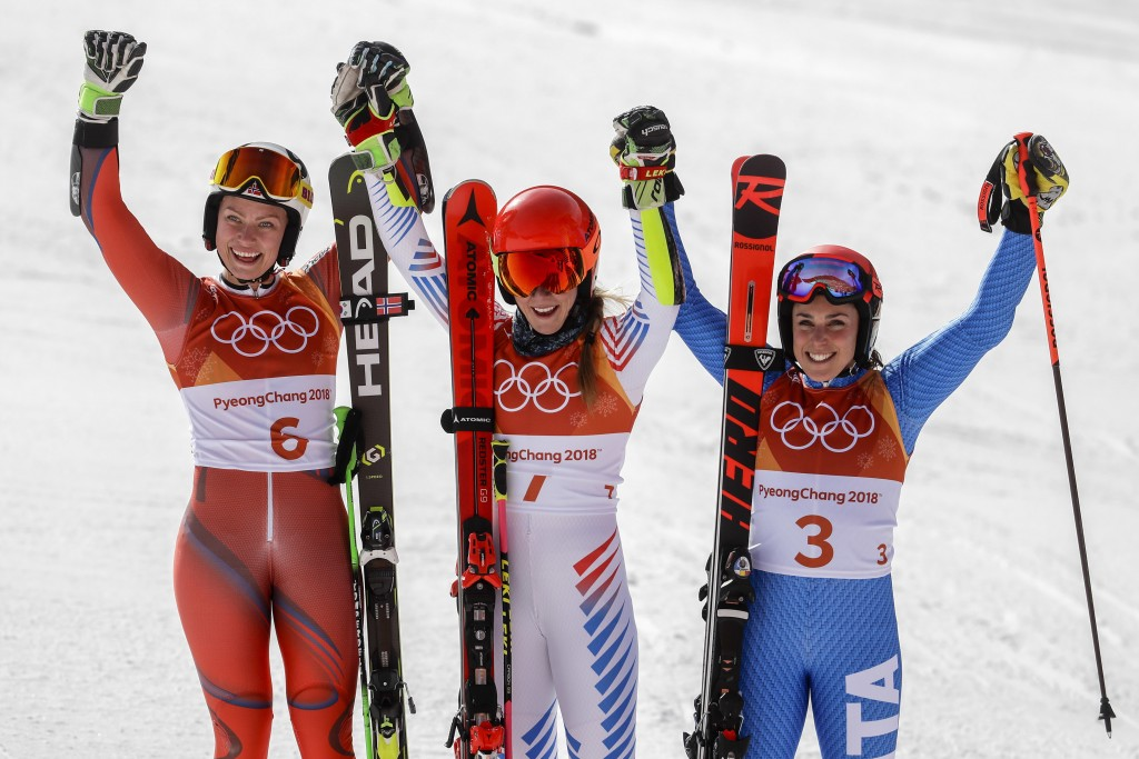 Silver medalist Ragnhild Mowinckel, of Norway, left, gold medalist Mikaela Shiffrin, of the United States, and bronze medalist Federica Brignone, of I