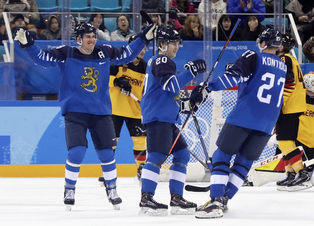 Eeli Tolvanen (20), of Finland, celebrates after scoring a goal against Germany during the second period of the preliminary round of the men's hockey